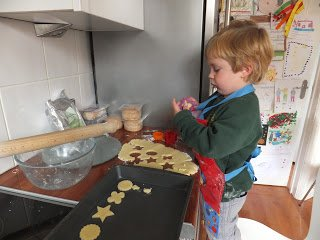My son making gluten free cheese biscuits