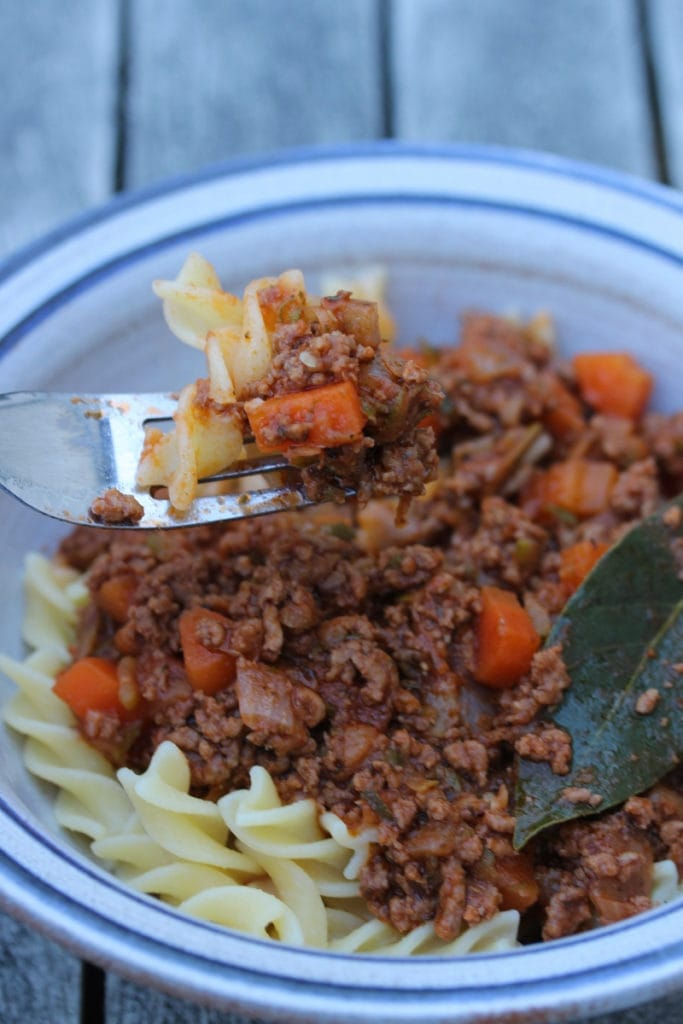 Pasta bolognese served in a bowl with a bay leaf on top #glutenfreedinner #coeliacfood