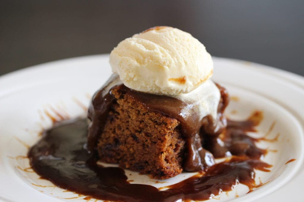 A perfect sticky toffee pudding with ice cream on top. Made with the Free From Fairy's wholegrain gluten free flour blend. #glutenfree #dairyfree #stickytoffeepudding #stickytoffeedesert #freefromfairy