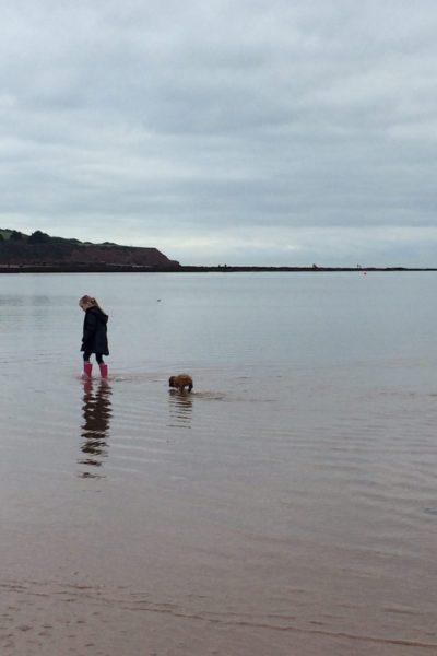 Devon beach with daughter and dog