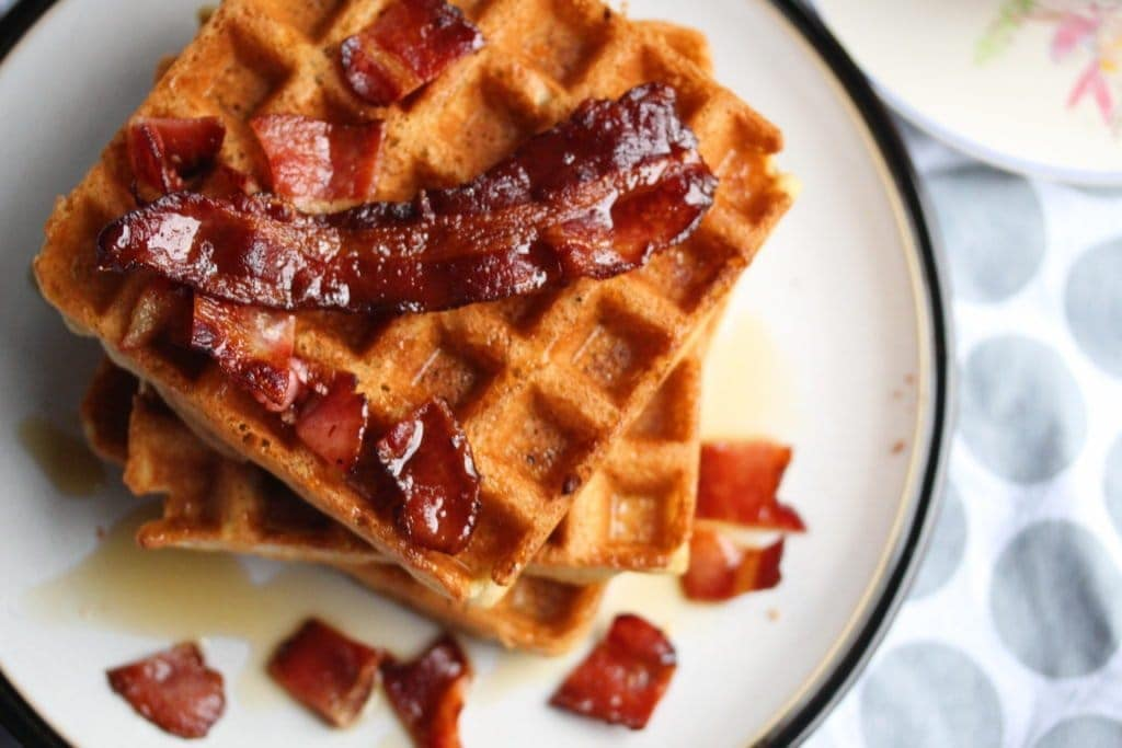 Luxurious gluten-free Belgian waffles with crispy bacon and maple syrup. These are made with the Free From Fairy's wholegrain gluten-free (and rice-free) flour blends.