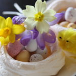 Easter meringue nest with flowers and chick