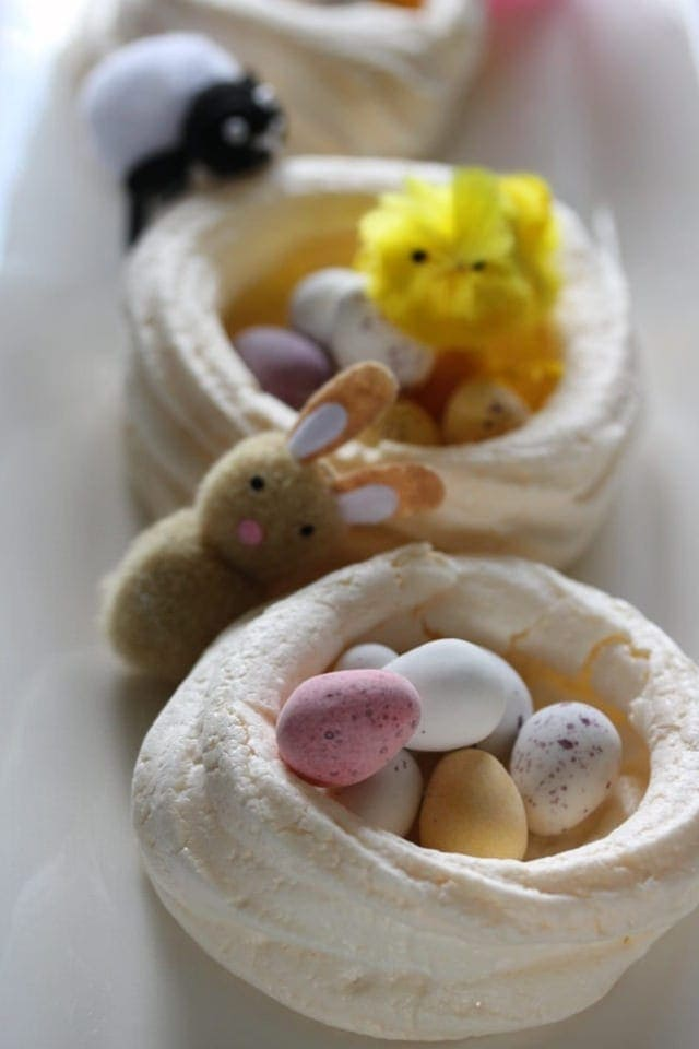 Meringue nest with mini eggs and baby animals