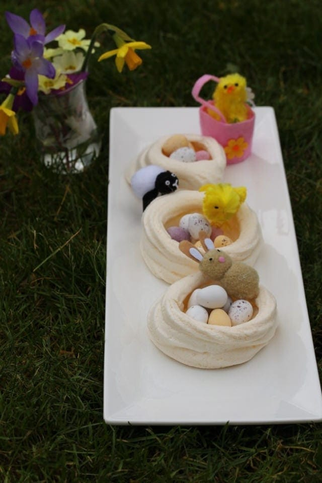 Easter nests with baby animals on the grass