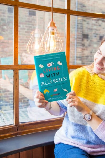 Emma Amoscato with Living with Allergies book