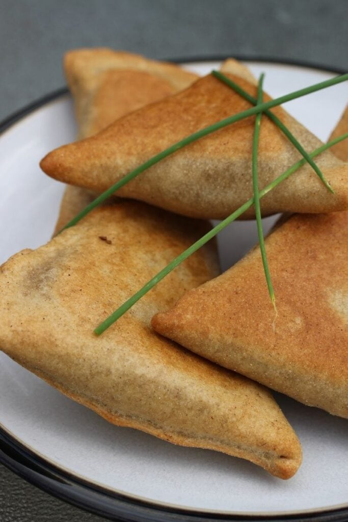 Gluten free samosas close up view with chives on top