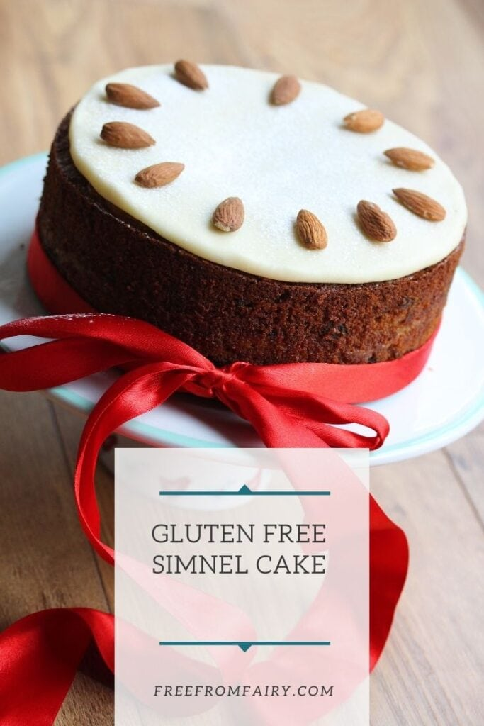 Gluten free simnel cake. A rich, moist gluten free fruit cake with marzipan baked in the middle and a marzipan disk on the top. #glutenfreeeaster #glutenfreeeasterrecipe #glutenfreesimnelcake #freefromfairy